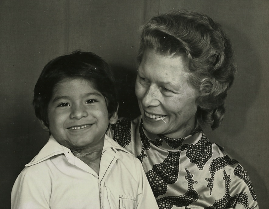 The boy with a beaming Mrs. Myra Polinger, who adored him as one of her favorite foster children